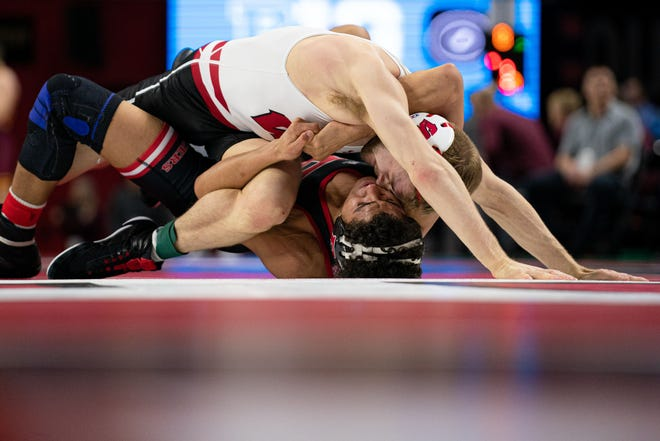 Seth Gross (top) scored Wisconsin's highest finish, third at 133 pounds, at the Big Ten Championships on Sunday in Piscataway, New Jersey.