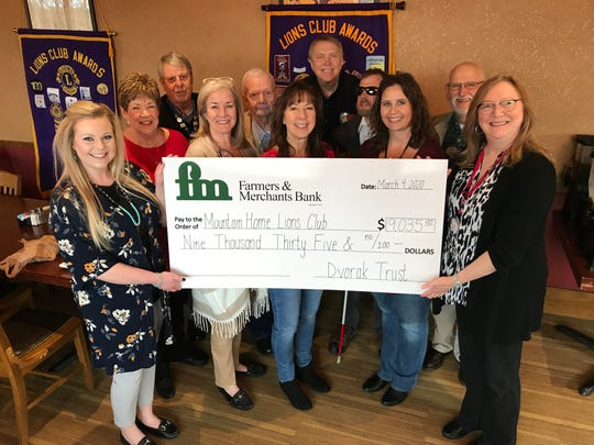 Farmers & Merchants Bank recently donated $9,035 to the Mountain Home Lions Club on behalf of the Adeline A. Hais Dvorak Living Trust administered by Farmers and Merchants Bank Trust & Wealth Management Services. Pictured are (front row, from left) Amber Henry, Beverly Sandvos, Brenda Dover, Angela Broome, Janet Evans, (back row, from left) Jonelle Luman, Rock Engeler, Gary Stricklin, Tim Herold and Keith Sharp.