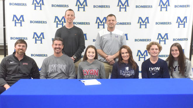 Mountain Home's Sydney Czanstkowski signed a National Letter of Intent on Monday to play golf at Lyon College. Pictured at her signing Monday are: (first row, from left) Lyon golf coach Travis Lauterbach, Tom Czanstkowski, Sydney Czanstkowski, Jill Czanstkowski, Jacob Czanstkowski, Ali Czanstkowski, (second row) Mountain Home golf coach Tim Carver, and former Mountain Home golf coach Dell Leonard.