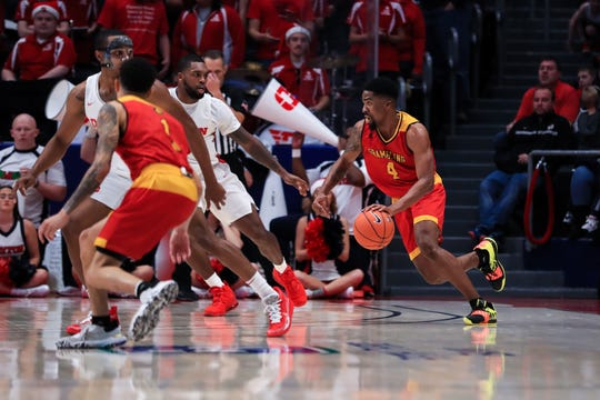 Dec 23, 2019; Dayton, Ohio, USA;  Grambling State Tigers guard Anthony Gaston (4) controls the ball against the Dayton Flyers in the second half at University of Dayton Arena. Mandatory Credit: Aaron Doster-USA TODAY Sports