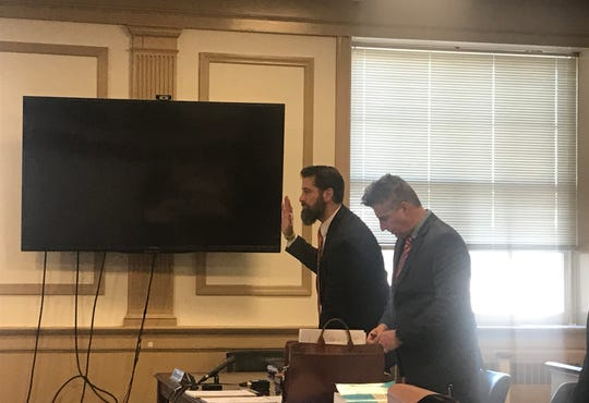 Christopher Esnes (left) pleads guilty to invasion of privacy in state Superior Court in Morristown on March 9, 2020.