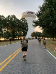 At least 17% of AUM students are affiliated with the military and 5% are veterans or current service members. Members of AUM ROTC's Mustang Battalion engage in an early morning ruck march.