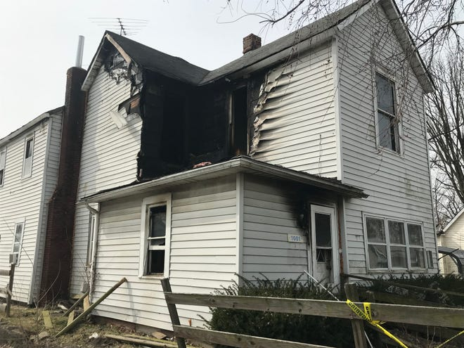 A house fire early Monday that severely damaged a house on West Powers Street remains under investigation.