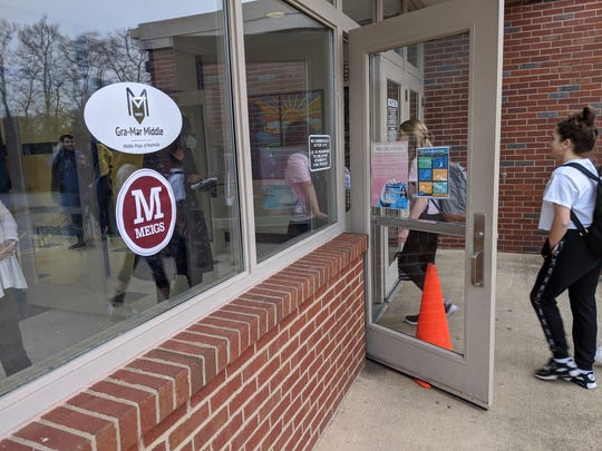 Meigs Academic Magnet students head to school at the Gra-Mar Middle School building on March 9, 2020, in Nashville, Tennessee after a tornado the week before damaged the East Nashville school.