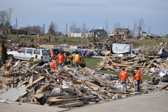 Volunteers with the nonprofit Samaritan's Purse work to sort and clear tornado debris on Hensley Drive in Putnam County, Tennessee, March 9, 2020.
