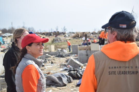 Tennessee first lady Maria Lee receives instructions from Samaritan's Purse team leader Michael Brunell before helping sort tornado debris in Putnam County, Tenn., on March 9, 2020.