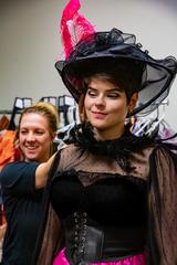 "Wardrobe supervisor Amanda McGee works with Chelsea Lehnea on her costume as the eye-catching Musetta in ""La Boheme."""