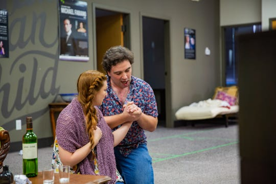 "Sarah Tucker, as Mimi, and Peter Lake, as Rodolpho, rehearse the famous aria from their meeting ""Che gelida manina"" (What a cold little hand) for the Gulfshore Opera production of ""La Boheme."""
