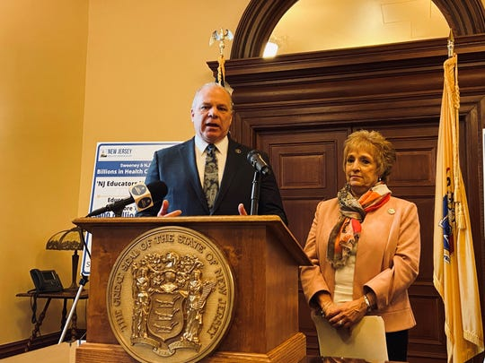 Senate President Stephen Sweeney, D-Gloucester, and NJEA president Marie Blistan announce an agreement to create two new healthcare plans for teachers that could save the state hundreds of millions of dollars a year.