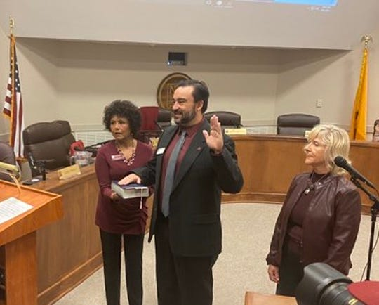 New Mexico State University Regent Arsenio Romero, center, is flanked by regents Ammu Devasthali, left, and Deb Hicks, right, as he is sworn in ahead of his first board of regents meeting on Monday, March 9, 2020.