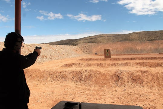 James Patterson practices pistol shooting at the Sidney Paul Gordon Shooting Range in La Luz.