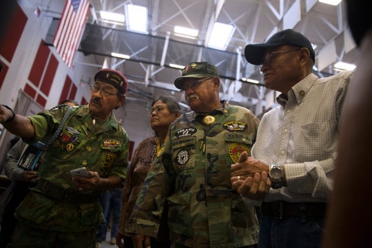 At left, Nelson Joe and Jasper Walker, third from left, look at a map of Vietnam on Sept. 21, 2017 during a Vietnam Veterans Pinning Ceremony at Navajo Technical University in Crownpoint.