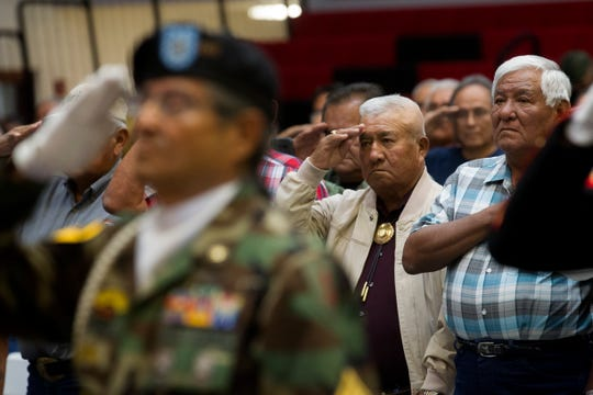 Vietnam veterans salute during the presentation of colors on Sept. 21, 2017 at a Vietnam Veterans Pinning Ceremony at Navajo Technical University in Crownpoint.