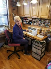 Vicki Arnold at her quilting machine in her home studio.
