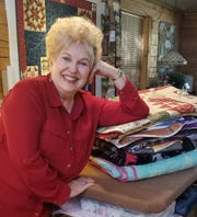 Vicki Arnold with some of her quilt.