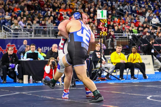 Catholic Central heavyweight Steven Kolcheff faces Livonia Franklin's Jake Swirple in the state heavyweight final.