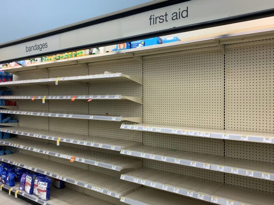 First aid supply shelves are out of stock at Walgreens in Palm Desert Monday, March 9, 2020.