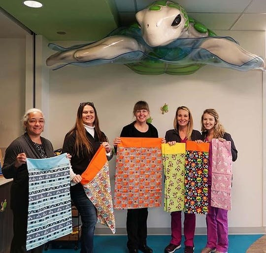 West Florida Libraries donates pillowcases to Children's Hospital.