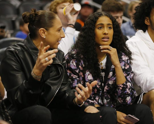 Phoenix Mercury guard Diana Taurasi talks with new teammate Skylar Diggins-Smith before an NBA game between the Phoenix Suns and the Milwaukee Bucks in Phoenix March 8, 2020.