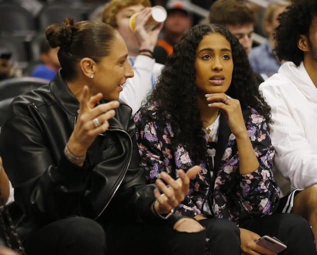 Phoenix Mercury guard Diana Taurasi talks with new teammate Skylar Diggins-Smith before an NBA game between the Phoenix Suns and the Milwaukee Bucks in Phoenix March 8, 2020.