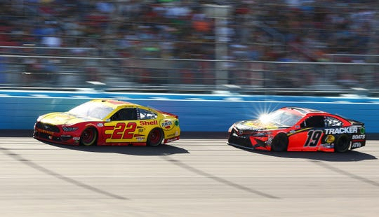 Monster Energy NASCAR Cup Series driver Joey Logano (22) is followed by Monster Energy NASCAR Cup Series driver Martin Truex Jr. (19) during the FanShield 500 at Phoenix Raceway on Mar. 8, 2020 in Avondale, Ariz.
