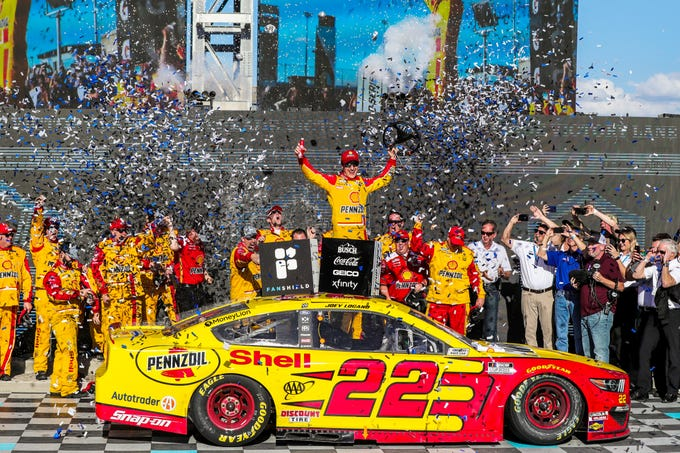 NASCAR Cup Series driver Joey Logano (22) celebrates in victory lane after winning the FanShield 500 on Mar. 8, 2020 at Phoenix Raceway in Avondale, AZ. (Brady Klain/The Republic)