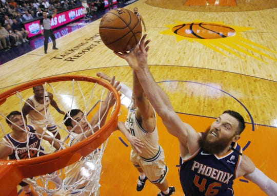 Phoenix Suns center Aron Baynes (46) rebounds the ball against Milwaukee Bucks center Brook Lopez (11) during the fourth quarter in Phoenix March 8, 2020.