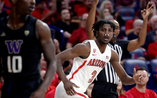 "Arizona coach Sean Miller had no complaints with how hard guard Dylan Smith (3) played in Saturday's loss. ""You know, the kid broke his nose,"" Miller said. ""Just got his nose smashed. He played, and in the second half, he's the reason we stayed in the game."""