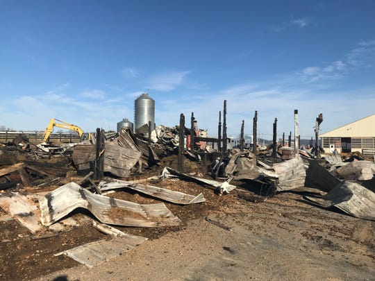 What's left of a barn at Crane Thoroughbreds were 15 horses died in a fire Saturday. Seven others were able to make it out in time.