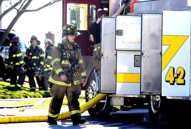 Firefighters respond to a neighborhood that was evacuated due to a gas leak Monday, March 9, 2020. All residents of the first block of Kevin Drive in Jackson Township were evacuated from their homes Monday because of a gas leak, according to York County 911.  Bill Kalina photo