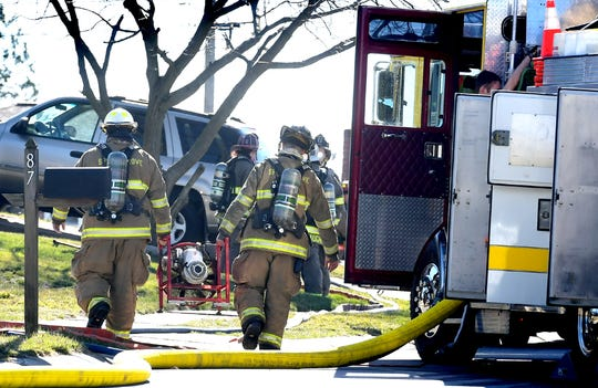 Firefighters carry equipment into an area that was evacuated due to a gas leak Monday, March 9, 2020. All residents of the first block of Kevin Drive in Jackson Township were evacuated from their homes Monday because of a gas leak, according to York County 911. Bill Kalina photo