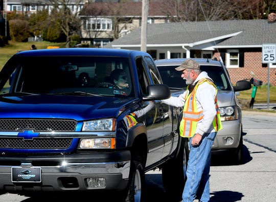 A fire policeman talks with a motorist exiting a neighborhood that was evacuated due to a gas leak Monday, March 9, 2020. All residents of the first block of Kevin Drive in Jackson Township were evacuated from their homes, according to York County 911.  Bill Kalina photo