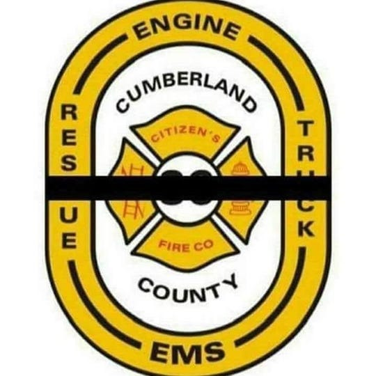 A Citizen's Fire Co. badge with black band, in memory of fallen firefighter Jerome Guise, who died Monday at a house fire in Boiling Springs, Cumberland County.