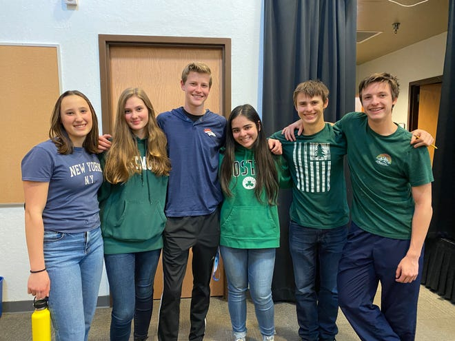 Samantha Kenyherz, Lilli De Jonghe, Spencer Abts, Isabella Nunez, Caleb Briggs and Jared Briggs at Sage Ridge School wore blue and green in support of Damonte Ranch High School on Monday, March 9. Five Damonte students have died since January, including two recently in a suspected murder-suicide.