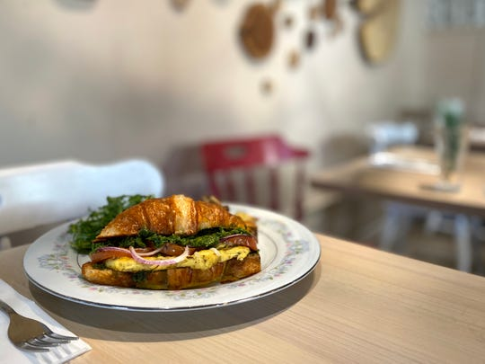 "The Easter Brunch special at Red Fern will be the vegan croissant breakfast sandwich with ""egg,"" mozzarella, roasted tomatoes, red onion and pesto. It will be served with home fries and an arugula side salad with ""bacon"" vinaigrette."