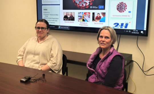 Shasta County Public Health Branch Director Brandy Isola, left, and Karen Ramstrom, county health officer, on Sunday discuss the first confirmed coronavirus case in the county.