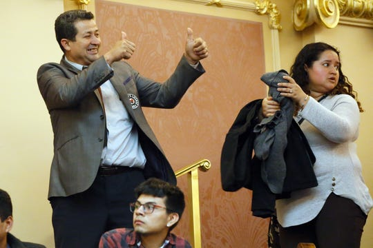 "A visitor to the House gallery gives a thumbs up to fellow visitors after the house passed legislation relating to state ID cards during the House session at the Capitol Saturday  in Richmond. Lawmakers voted not to allow undocumented immigrants to get normal driver's licenses, but instead created a special new category IDs called a ""driver privilege card."""