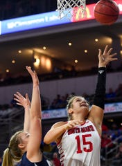 USD's Taylor Frederick makes a layup during the Summit League tournament semifinals on Monday, March 9, at the Denny Sanford Premier Center in Sioux Falls.