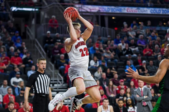 USD's Tyler Peterson (22) saves a ball from going out of bounds during the Summit League tournament game against North Dakota on Sunday, March 8, 2020 at the Denny Sanford Premier Center.