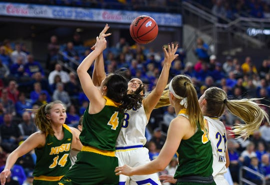 SDSU's Lindsey Theuninck and NSDU's Sofija Zivaljevic reach for a rebound during the Summit League tournament semifinals on Monday, March 9, at the Denny Sanford Premier Center in Sioux Falls.