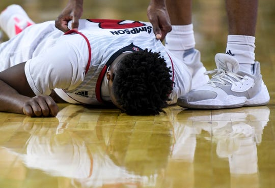USD's Triston Simpson (3) falls to the ground after attempting a shot in the final seconds of the game against North Dakota during the Summit League tournament on Sunday, March 8, 2020 at the Denny Sanford Premier Center.