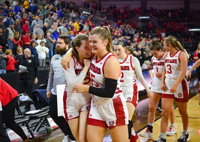 USD's Chloe Lamb and Taylor Frederick laugh as they walk off the court arm-in-arm after winning the Summit League tournament semifinal game against Oral Roberts on Monday, March 9, at the Denny Sanford Premier Center in Sioux Falls.