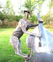 Doggie Plays Bass by Scott Schlagg is one of the 2020 SculptureWalk entries.
