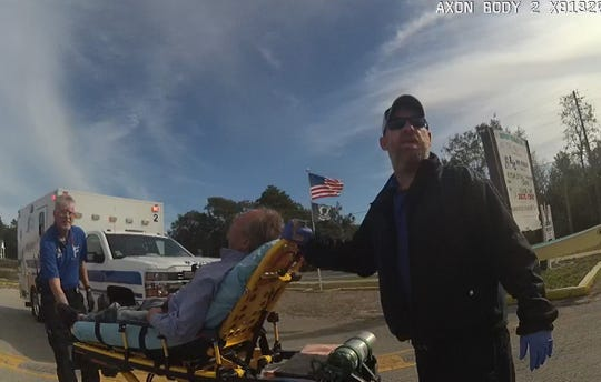 Franklin County emergency medical workers wheel FBI Special Agent Alexis Hatten to an ambulance following a Dec. 20 incident with deputies in Carrabelle.