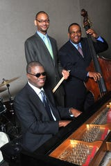 Marcus Roberts Trio, from left to right: Marcus Roberts, Jason Marsalis and Rodney Jordan will perform Ellington works at Carnegie Hall.