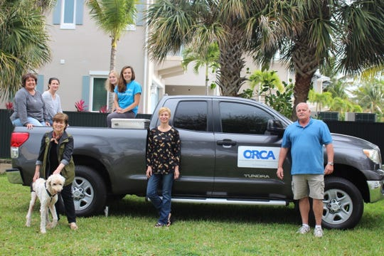 """Staffers at the Ocean Research & Conservation Association pose with the 2011 Toyota Tundra pickup the organization was able to buy with donations through TCPalm's """"12 Days of Christmas"""" project."""
