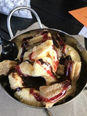 Still have room? Try the churro sundae dessert with ribbons of chocolate and strawberry sauce. ($7)
