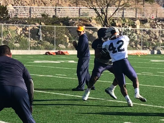 UTEP defensive end Deylon Williams works on his pass rushing skills during a spring practice drill Monday at Glory Field