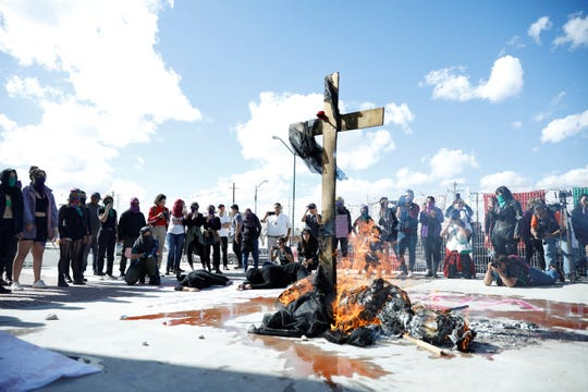 Protesters burn an effigy at a demonstration against femicides Monday in Juárez.