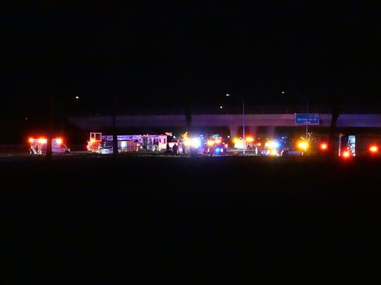 Ventura County sheriff's and firefighting vehicles lined northbound Highway 101 near the Las Posas Road overpass in Camarillo Sunday night after a suspect failed to yield and crashed into ice plant.